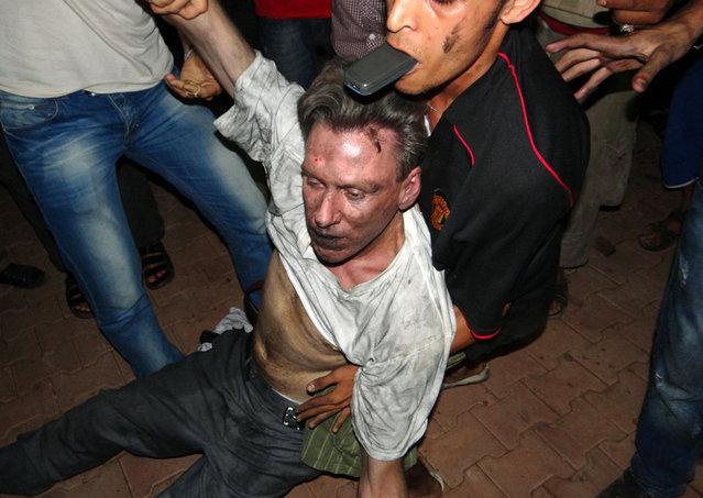 US ambassador to Libya, Chris Stevens, in the hands of Libyans.