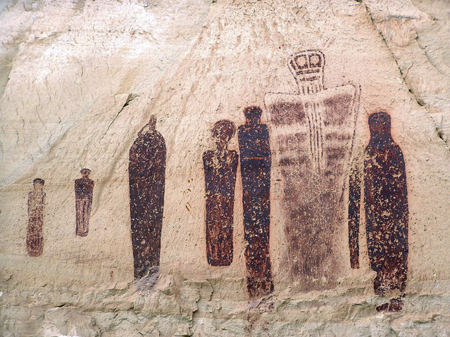 This undated file photo provided by Utah State University shows the Holy Ghost group of the Great Gallery, a striking Barrier Canyon-style rock painting in Horseshoe Canyon of southern Utah's Canyonlands National Park. Life-sized figures sketched into red rock cliffs in Canyonlands National Park were drawn 1,000 years more recently than what had long been believed, a team of Utah State University scientists discovered about the world-renowned rock art. (Photo by Joel Pederson/AP Photo/Utah State University)