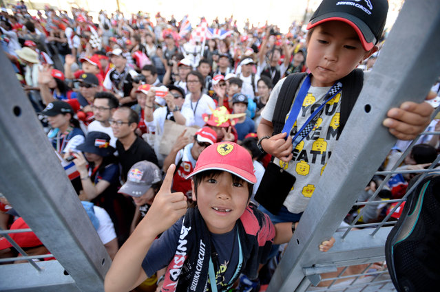 Spectators gather during the podium ceremony of the Japanese Formula One Grand Prix at the Suzuka Circuit in Suzuka, central Japan, 08 October 2017. British Formula One driver Lewis Hamilton of Mercedes AMG GP won the race. (Photo by Franck Robichon/EPA/EFE)