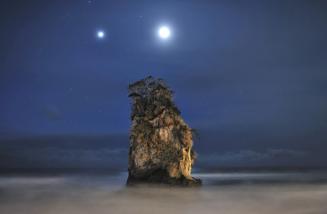 With a Couple of Jovian and Lunar Lights: Jupiter and the Moon light up the sky above a rock formation near Kitaibaraki City, Japan. (Photo by Dr. Akira Takaue/National Geographic Photo Contest