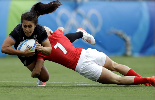 New Zealand's Shakira Baker, left, is tackled by Great Britain's Heather Fisher, during the women's rugby sevens semi final match at the Summer Olympics in Rio de Janeiro, Brazil, Monday, August 8, 2016. (Photo by Themba Hadebe/AP Photo)