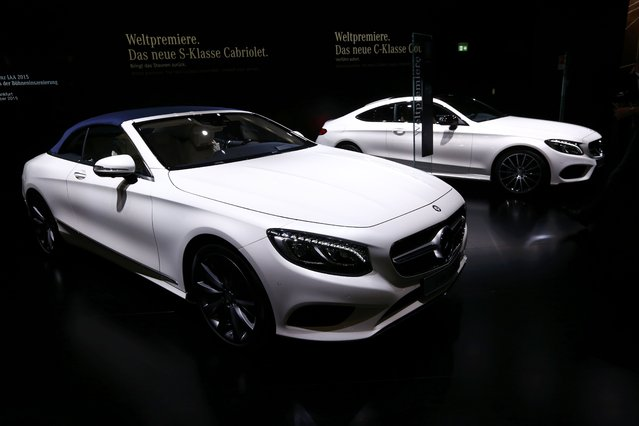 A new Mercedes-Benz S-Class S500 (L) convertible car is pictured at the booth of Mercedes-Benz during the media day at the Frankfurt Motor Show (IAA) in Frankfurt, Germany, September 14, 2015. The new Mercedes C-class coupe is seen at right. (Photo by Ralph Orlowski/Reuters)