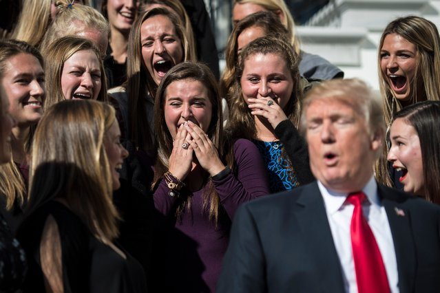 Members of the University of Maryland women's lacrosse team react to something Trump said after posing for photographs during an event with NCAA championship teams at the White House on November 17, 2017. (Photo by Jabin Botsford/The Washington Post)
