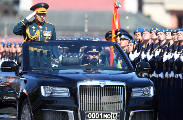 Russian Defence Minister Sergei Shoigu drives an Aurus cabriolet during the Victory Day Parade in Red Square in Moscow, Russia, June 24, 2020. (Photo by Iliya Pitalev/Host Photo Agency via Reuters)