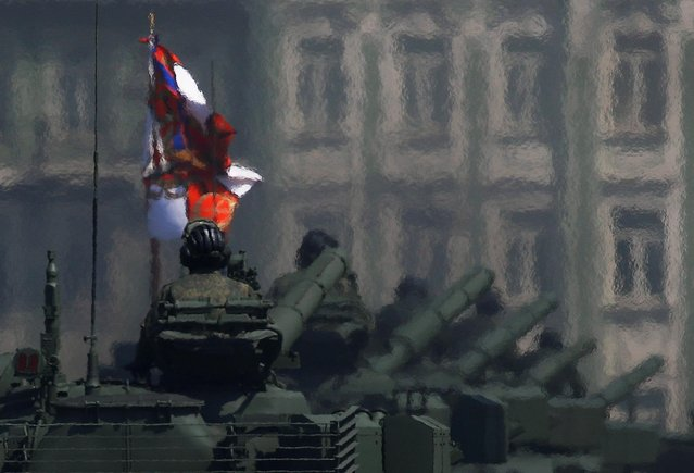 Russian servicemen ride tanks along the street during a rehearsal for the Victory Day parade in Moscow, Russia June 20, 2020. The military parade marking the 75th anniversary of the victory over Nazi Germany in World War Two was planned for May 9 and postponed due to the outbreak of the coronavirus disease (COVID-19). (Photo by Maxim Shemetov/Reuters)