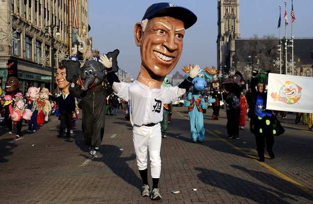 "A ""big head"" of the Detroit Tigers' former manager Sparky Anderson participates in the 86th annual America's Thanksgiving Day Parade in Detroit. (Photo by Elizabeth Conley/The Detroit News)"