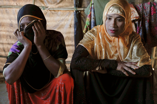 Relatives of 11-month-old Rohingya refugee Abdul Aziz mourn after his body was brought back to the family shelter at the Balukhali refugee camp near Cox's Bazar, Bangladesh, a few hours after he died December 4, 2017. Aziz, whose family fled Myanmar some two months ago, died at a local clinic after suffering from high fever and severe cough for ten days, his mother said. (Photo by Damir Sagolj/Reuters)