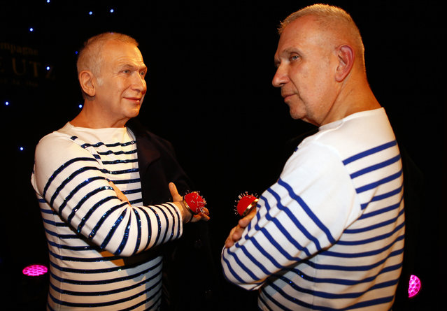 Fashion designer Jean Paul Gaultier, right, poses next to the life-size wax model presented by the Grevin Museum in Paris, Monday, December 18, 2017. The Grevin Museum was founded in 1882 and is one of the oldest wax museum in Europe. (Photo by Francois Mori/AP Photo)