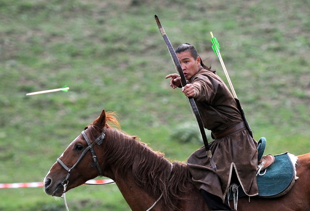 Mognolia's Serul competes in horseback archery at the 2016 World Nomad Games in Cholpon-Ata, Kyrgyzstan on September 5, 2016. (Photo by Viktor Drachev/TASS via Getty Images)