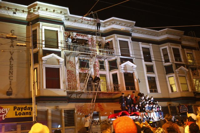 Revellers celebrate in the Mission District, in San Francisco, California October 29, 2014. (Photo by Stephen Lam/Reuters)