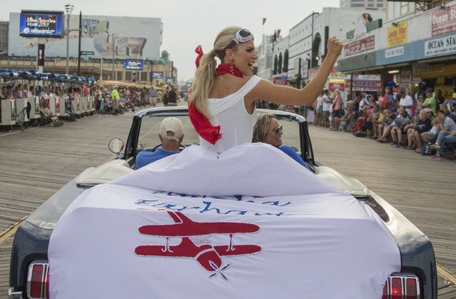"Miss Kansas Kendall Ellen Schoenekase waves to the crowd during the 2017 Miss America pageant ""Show Us Your Shoes"" parade Saturday, September 10, 2016, in Atlantic City. (Photo by Chris Szagola/AP Photo)"