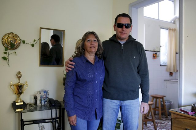 Laura Paipo, first blind principal in Uruguay poses with her husband Jorge Albarracin at their home in Montevideo, September 18, 2015. (Photo by Andres Stapff/Reuters)