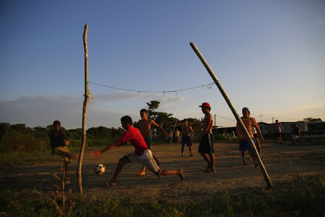 Children play football in the village of Congo Mirador in the western state of Zulia October 21, 2014. (Photo by Jorge Silva/Reuters)