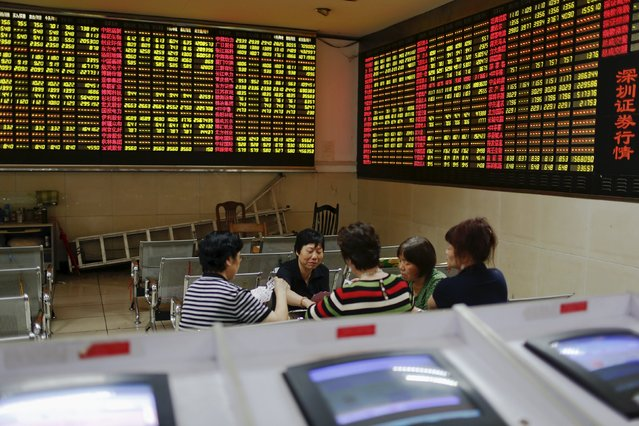 Investors play cards during a mid-day break at a brokerage house in Shanghai, China, July 8, 2015. Some are in it just for the money, others to help buy a meal. (Photo by Aly Song/Reuters)