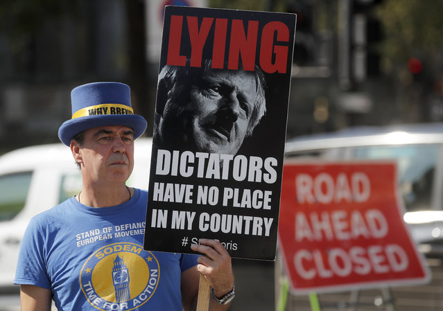A pro EU protester stands near Parliament in London, Monday, September 14, 2020. Boris Johnson is facing the possibility of a Tory rebellion and major damage to his chances of a trade deal with the EU unless he removes controversial parts of the internal Bill which is in the House of Commons for its second reading Monday. (Photo by Frank Augstein/AP Photo)
