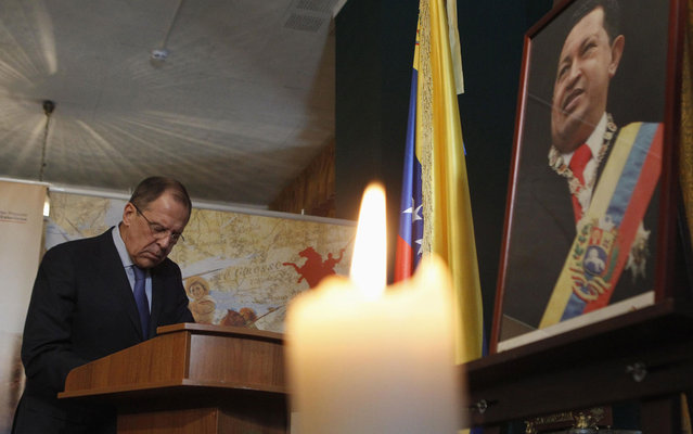 The Russian Foreign Minister, Sergei Lavrov, write in a book of condolence visit to the Embassy of Venezuela in Moscow in tribute to Hugo Chavez. (Photo by Maxim Shemetov/Reuters)