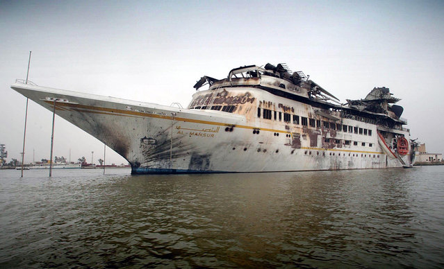 "The damaged ""Al Mansur"", Iraqi President Saddam Hussein's private yacht, anchored in central Basra, on April 10, 2003. (Photo by Simon Walker/Reuters/The Atlantic)"