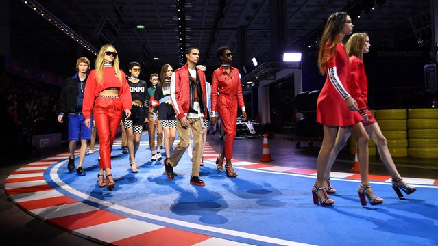 Models present creations by Tommy Hilfiger during the Milan Fashion Week, in Milan, Italy, 25 February 2018. (Photo by Daniel Dal Zennaro/EPA/EFE)