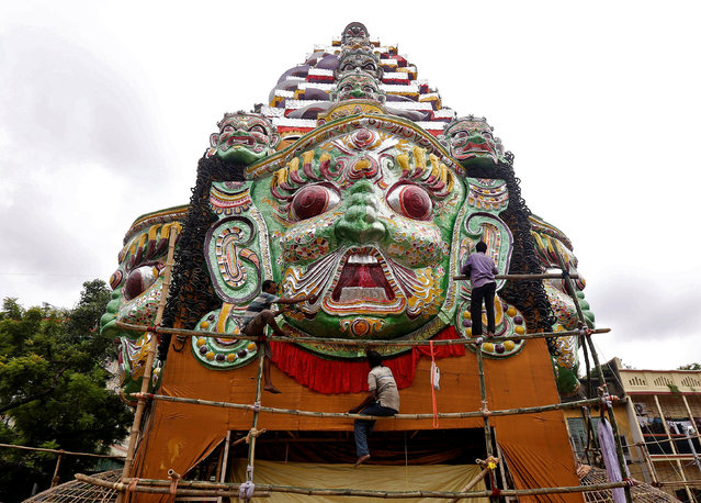 Artisans work on a giant model of mythological demon Mahishasura on a pandal, or a temporary platform, during preparations for the upcoming Durga Puja festival in Kolkata, September 28, 2016. (Photo by Rupak De Chowdhuri/Reuters)