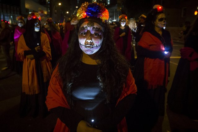 "A woman dressed in a ""Dia de Muertos"" or ""Day of the Dead"" theme participates in the Greenwich Village Halloween Parade in the Manhattan borough of New York, October 31, 2015. (Photo by Carlo Allegri/Reuters)"