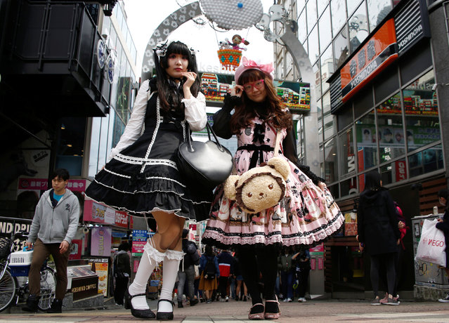 "Ai (R) and Hamuka dressed in ""Lolita fashion"", influenced by Victorian style, pose for a photographs at  Harajuku shopping district in Tokyo, Japan March 15, 2018. (Photo by Kim Kyung-Hoon/Reuters)"