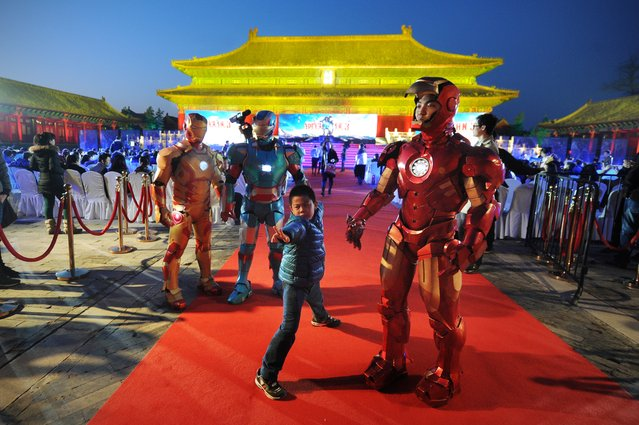 """This picture taken on April 6, 2013 shows a boy posing during a promotional event for the Hollywood movie """"Iron Man 3""""  at the Forbidden City in Beijing. (Photo by Wang Zhao/AFP Photo)"""