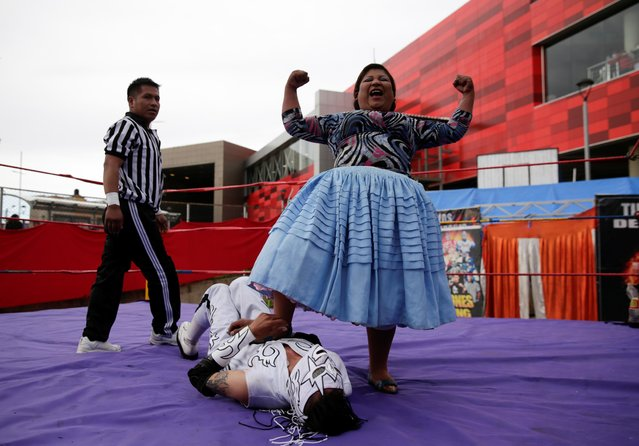 Silvana La Poderosa, a cholita wrestler, reacts after winning a fight during their return to the ring after the coronavirus disease (COVID-19) restrictions, in El Alto outskirts of La Paz, December 6, 2020. (Photo by David Mercado/Reuters)