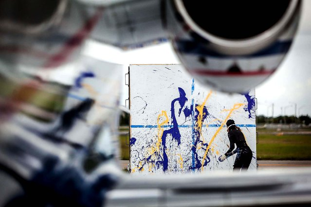 Von Anhalt paints in the jet wash. (Photo by Thomas Cordy/The Palm Beach Post)