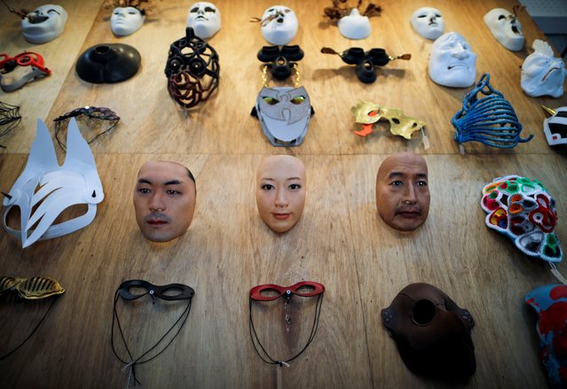 Masks based on real people's faces are diplayed at the Shuhei Okawara's mask shop Kamenya Omote in Tokyo, Japan on December 16, 2020. (Photo by Issei Kato/Reuters)