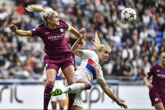 Lyon's Norwegian forward Ada Egerberg (R) vies with Manchester City's English defender Steph Houghton during the French C1 women semifinal football match Olympique Lyonnais (OL) vs Manchester City on April 29, 2018, at the Parc Olympique Lyonnais stadium in Decines-Charpieu, central-eastern France. (Photo by Jeff Pachoud/AFP Photo)