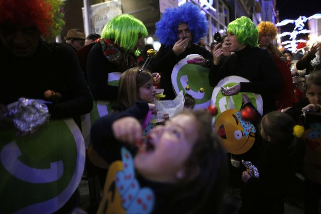 Revellers dressed up as a Whatsapp logo take part in the Spanish tradition of eating 12 grapes at midnight, as they take part in New Year's celebrations in Coin, near Malaga, southern Spain, early January 1, 2015. (Photo by Jon Nazca/Reuters)