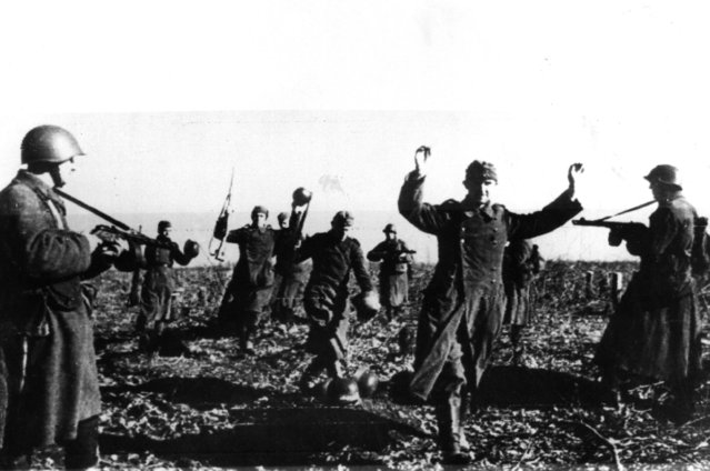 German troops throw down their steel helmets as they surrender on the Kharkov Front, 4th May 1942. (Photo by Hulton Archive/Getty Images)