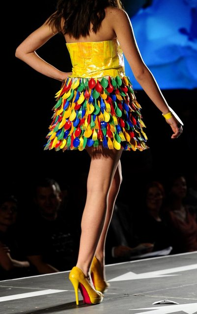 A model presents a creation made of plastic cutlery during Trash Fashion Show in Macedonia's capital Skopje, on Wednesday, June 5, 2013. Teams from 47 high schools from Macedonia participated in the show with creations made of redesigned materials from waste such as plastic bags, newspapers, cardboard, plastic bottles, cans, used paper, etc. (Photo by Boris Grdanoski/AP Photo)