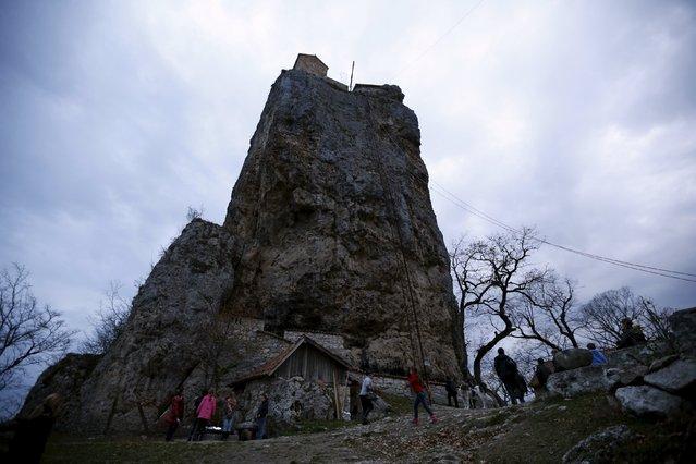 People walk near the church on top of the Katskhi Pillar, a rock mass about 40 meters high, in the village of Katskhi, Georgia, November 27, 2015. (Photo by David Mdzinarishvili/Reuters)