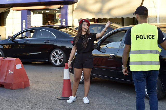 A Lebanese university student wearing municipality police costume regulates the traffic in the village of Brummana, east Beirut, Lebanon, 23 June 2018. (Photo by Wael Hamzeh/EPA/EFE)