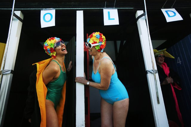 Swimmers prepare to get into the water during the UK Cold Water Swimming Championships at Tooting Bec Lido in south London January 24, 2015. (Photo by Luke MacGregor/Reuters)