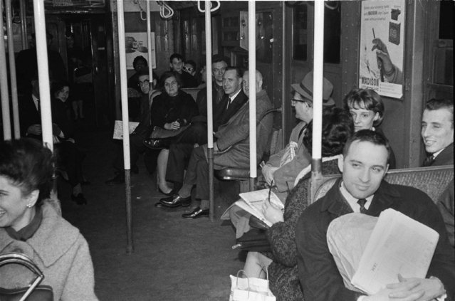 Passengers sit patiently in near-darkness in a stalled subway car at West 4th Street in the Manhattan section of New York, November 9, 1965, during the massive power failure that darkened a vast portion of the northeast including New York State, most of New England, parts of New Jersey and Pennsylvania, and Ontario, Canada. (Photo by Jerry Mosey/AP Photo)