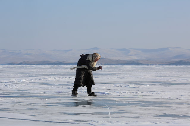 Lyubov Morekhodova, aged 79, skates on ice-covered Lake Baikal in Irkutsk Region, Russia on January 29, 2021. Lyubov, who runs the house on the lakeside near remote villages of Irkutsk Region, learnt to skate in her early childhood and then was committed to this hobby throughout the course of her life. (Photo by Yuri Novikov/Reuters)