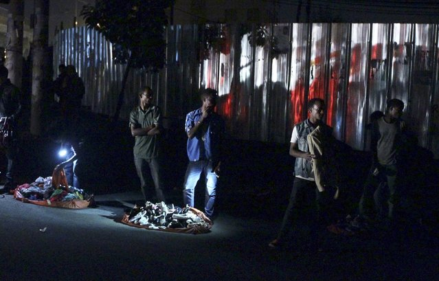 Vendors sell used clothes and shoes at night at the Mercato market in Addis Ababa June 14, 2015. (Photo by Tiksa Negeri/Reuters)