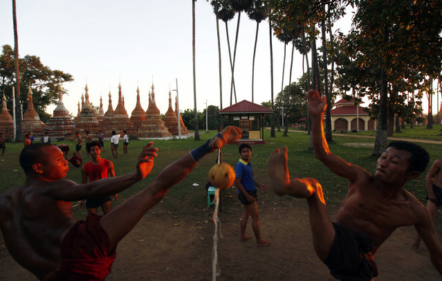 A group of men play Myanmar's traditional sport of chinlone in Naypyitaw, Myanmar, Friday, November 18, 2016. (Photo by Aung Shine Oo/AP Photo)