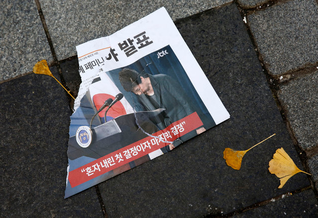 A leaflet denouncing South Korean President Park Geun-hye lies on the ground after it was torn at a protest calling Park to step down, in Seoul, South Korea, November 19, 2016. (Photo by Kim Hong-Ji/Reuters)
