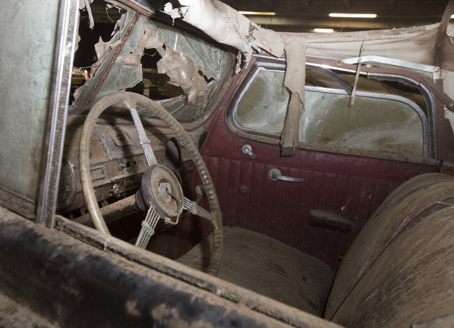 Packard Eight Cabriolet is displayed during a preview for an auction of vintage cars Retromobile show in Paris, Tuesday, February 3, 2015, after a treasure trove of classic cars was discovered after spending 50-years languishing in storage on a farm. (Photo by Jacques Brinon/AP Photo)