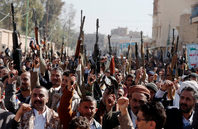 Yemenis hold up guns as they shout slogans during an anti-US protest in Sana'a, Yemen, 20 January 2021. According to reports, US Secretary of State Tony Blinken has pledged to immediately review the US terrorist designation of Yemen's Houthi movement a day after Donald Trump's government designated it as a Foreign Terrorist Organization (FTO). (Photo by Yahya Arhab/EPA/EFE)