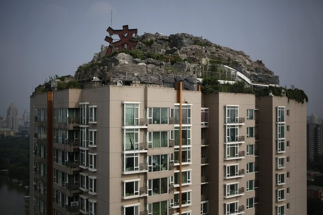According to local media, the privately built villa seen here has been under construction on the rooftop of a residential building in downtown Beijing for the past six years. (Photo by How Hwee Young/European Pressphoto Agency)