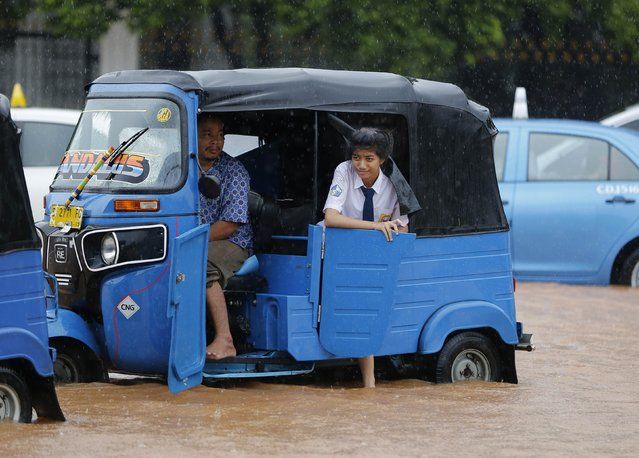 A student waits inside a Baja vehicle during a traffic jam caused by water on the roads after heavy seasonal rains flooded parts of Jakarta February 9, 2015. (Photo by Darren Whiteside/Reuters)