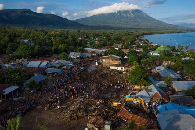 An aerial picture shows damaged houses following flash floods triggered by a tropical cyclone in East Flores, East Nusa Tenggara province, Indonesia, April 6, 2021. (Photo by Aditya Pradana Putra/Antara Foto via Reuters)
