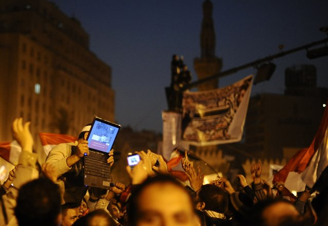 An opposition supporter holds up a laptop showing images of celebrations in Cairo's Tahrir Square, after Egypt's President Hosni Mubarak resigned in this February 11, 2011 file photo. Dylan Martinez: I was lucky enough to be sent to Egypt in 2011 for what became known as the Facebook Revolution. Thousands of Egyptians had taken to the streets to demand the end of President Hosni Mubarak's 30-year rule. (Photo by Dylan Martinez/Reuters)