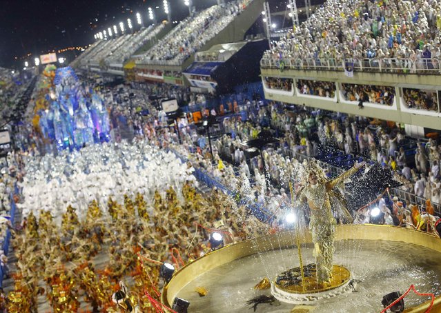 Revellers from the Viradouro samba school participate in the annual carnival parade in Rio de Janeiro's Sambadrome, February 15, 2015. (Photo by Ricardo Moraes/Reuters)