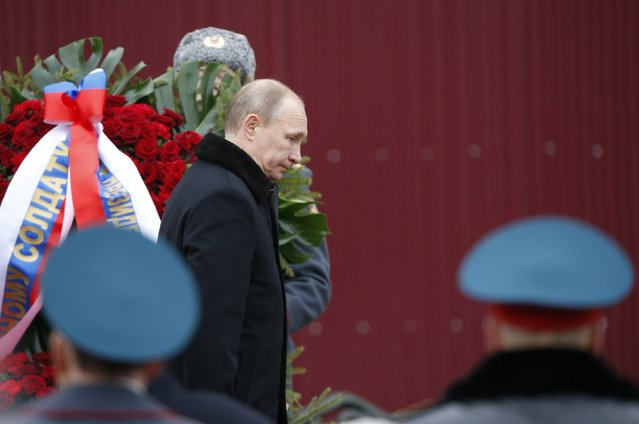 Russian President Vladimir Putin attends a wreath laying ceremony to mark the Defender of the Fatherland Day at the Tomb of the Unknown Soldier by the Kremlin walls in central Moscow February 23, 2015. (Photo by Sergei Karpukhin/Reuters)