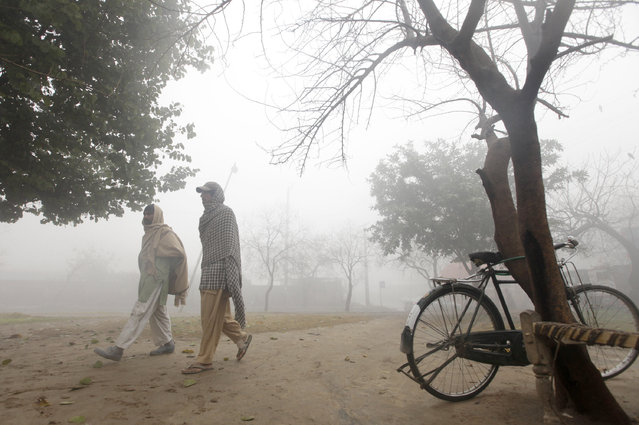 Men arrive to have breakfast at a tea stall on a foggy cold winter morning in Islamabad, Pakistan, January 13, 2016. (Photo by Faisal Mahmood/Reuters)
